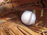Close-up of a Baseball in a Glove Photographic Print