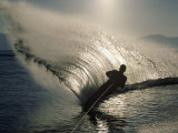 Waterskier Silhouetted with Sun Shining Through Water Photographic Print