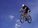 Flying Cyclist Photographic Print