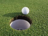 Close-up of a Golf Ball Near a Hole Photographic Print