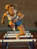 Leaping Over Hurdles Photographic Print
