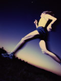 Low Angle View of a Young Woman Running Photographic Print