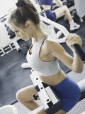 Young Woman Exercising in a Health Club Photographic Print