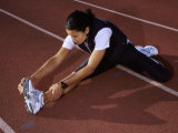 High Angle View of a Female Athlete Stretching on a Running Track Photographic Print