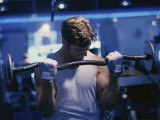 Young Man Exercising with Barbells Photographic Print