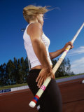 Low Angle View of a Female Athlete Pole Vaulting Photographic Print