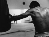 Monochromatic Image of a Boxer Working Out Photographic Print