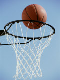 Close-up of a Basketball on The Edge of a Hoop Photographic Print