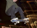 Skateboarder in Midair at Night Photographic Print