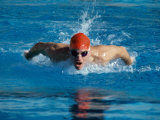 Young Man Swimming The Butterfly Stroke Photographic Print