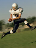 American Football Player Running on a Field Photographic Print