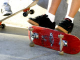 Close-up Image of Feet on Skateboards Photographic Print