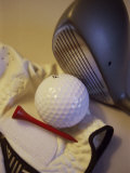 Golf Ball Near a Tee with a Glove and a Golf Club Photographic Print