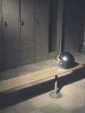Football Helmet on Bench in Locker Room Photographic Print