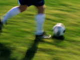 Low Section View of a Soccer Player Running with The Ball Photographic Print