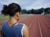 Close-up of a Female Athlete Standing on a Running Track Photographic Print