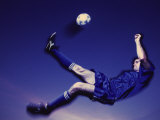 Soccer Player Kicking a Ball Photographic Print