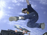 Skateboarder in Midair Doing a Trick Photographic Print