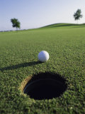 A Golf Ball Just Short of the Hole Photographic Print
