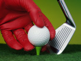 Gloved Hand Placing Golf Ball on Tee Photographic Print