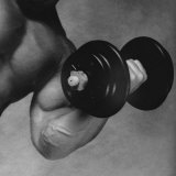 Close-up of a Man Lifting a Dumbbell Reproduction photographique