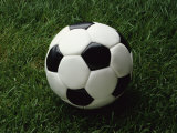 Soccer Ball in Grass Photographic Print