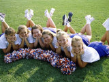 High Angle View of Cheerleaders Lying on a Lawn Photographic Print