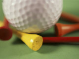 Close-up of a Golf Ball and Tees Photographic Print
