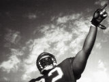 Low Angle View of An American Football Player Photographic Print