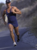 Man Jogging Down a Hill Photographic Print