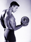 Male Bodybuilder Curling a Dumbbell Photographic Print