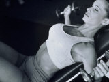 Young Woman Exercising with Dumbbells Photographic Print