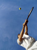 Tennis Player with Blue Sky Photographic Print