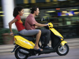 Young Couple Riding on a Motor Scooter Photographic Print