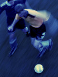 High Angle View of Two Soccer Players Running for a Soccer Ball Photographic Print