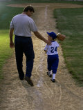 Rear View of a Man Walking with His Son at a Playing Field Photographic Print