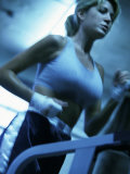 Low Angle View of a Young Woman Running on a Treadmill Photographic Print