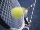 High Angle View of a Mid Adult Man Playing Tennis Photographic Print
