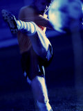 Soccer Player Kicking a Soccer Ball Reproduction photographique