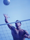 Young Man Playing Beach Volleyball Photographic Print