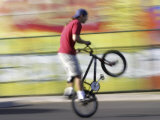 Bicyclist Riding on Rear Wheel Photographic Print