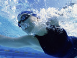 Low Angle View of a Mid Adult Woman Swimming Underwater Photographic Print