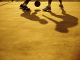 Low Section View of Two People Playing Basketball Photographic Print