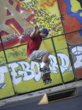 Skateboarder with Graffiti Background Photographic Print