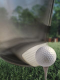 Close-up of a Golf Club Hitting a Golf Ball on a Tee Photographic Print