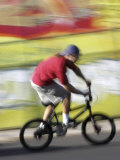Moving Bicycle and Rider Photographic Print