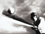 Low Angle View of a Baseball Player Swinging a Baseball Bat Photographie