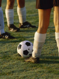 Low Section View of Soccer Players Feet and a Soccer Ball Photographic Print