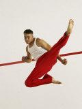 Young Man Kicking While Practicing Karate Photographic Print