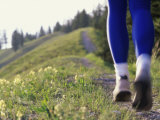 Ground Level View of Jogger on a Trail Photographic Print